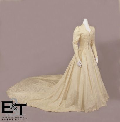 October 12, 1941: traditional style wedding gown in ivory brocade worn by Louise Hopkins for her marriage to Harris Faulkner Underwood II.
