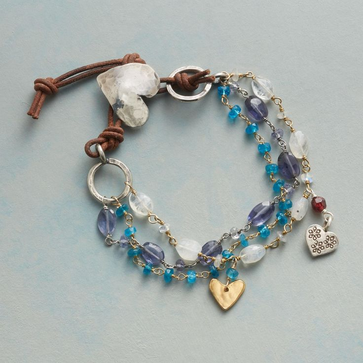 SINGSONG HEARTS BRACELET -- Sterling silver and 18kt gold plate hearts  serve as expressions of