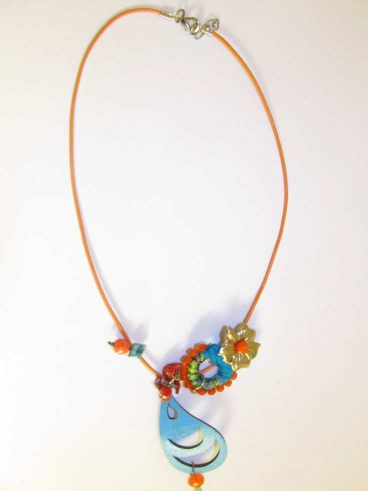 Handmade short leather necklace (1 pc)  Made with turquoise leather filigree, orange leather cord, silver tone metal flower, handmade with silk and glass beads, corals and glass beads.