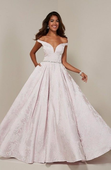 fb67dd280632 Style 16358 from Tiffany Designs is an off the shoulder prom gown with  Rhinestone belt