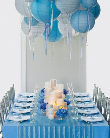 Beribboned lanterns in shades of blue make a big impact when strung above tabletops
