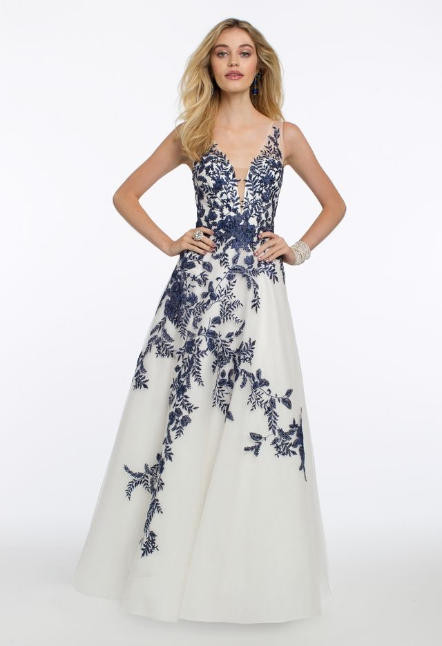 86ecf3de0f3 Channel your flirty side in this illusion trend dress! The plunging  neckline, fitted bodice, ball gown skirt and V back on this sleeveless long  prom dress ...