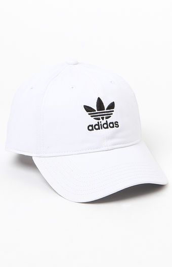 Top off your look with a street-style-approved cap provided by adidas. The Washed Strapback Dad Hat has a naturally curved bill, breathable embroidered eyelets, and adidas Trefoil embroideries on the front and back.    Washed, solid color dad hat  Embroidered adidas logos on front and back  Embroidered eyelets  Naturally curved bill  Adjustable strapback panel  One size fits most