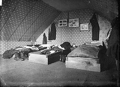 """Bedroom in """"The Old Shebang"""", Cuba Street, Wellington, ca 1883 by National Library NZ on The Commons"""