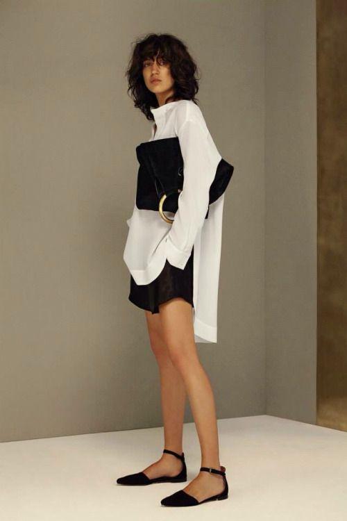 Oversized white shirt + D'orsay ankle strap flats + textured black shorts + oversized bag