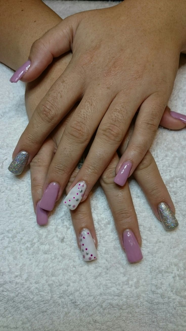 Acrylic tips + gel polish on clients hands. Purple, white and silver