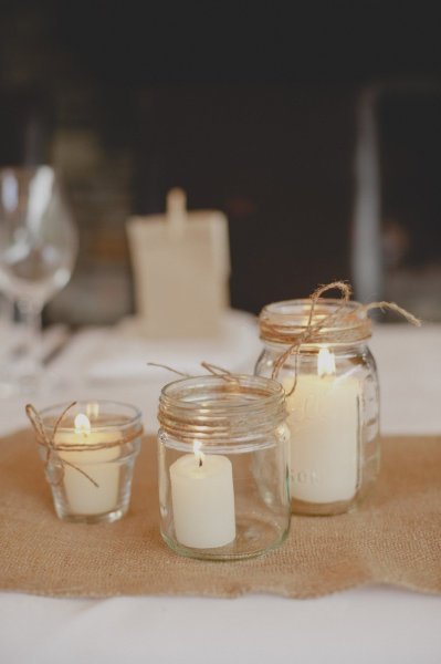 assorted glass jars and votives with twine wrapped around the rims
