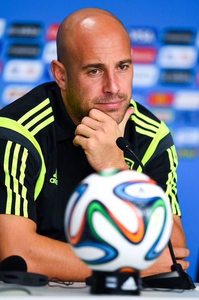 Pepe Reina Photos Photos - Pepe Reina of Spain faces the media during a Spain press conference ahead of the 2014 FIFA World Cup Group B match between Australia and Spain at Arena da Baixada on June 22, 2014 in Curitiba, Brazil. - Spain Training & Press Conference - 2014 FIFA World Cup Brazil
