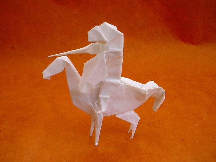 Peter Engel- Origami Model of a knight on a horse. I like how complex it looks and makes you wonder if has jus used the one piece of paper or two.