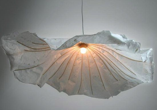 Rice paper lantern like a lotus leaf. The Chinese 'Innovo' design team exhibited their 'nong yi' works at the salone satellite in milan.  The lamp utilizes the methods and materials used to make classic chinese paper lamps and lanterns-bamboo stick, and traditional rice paper.