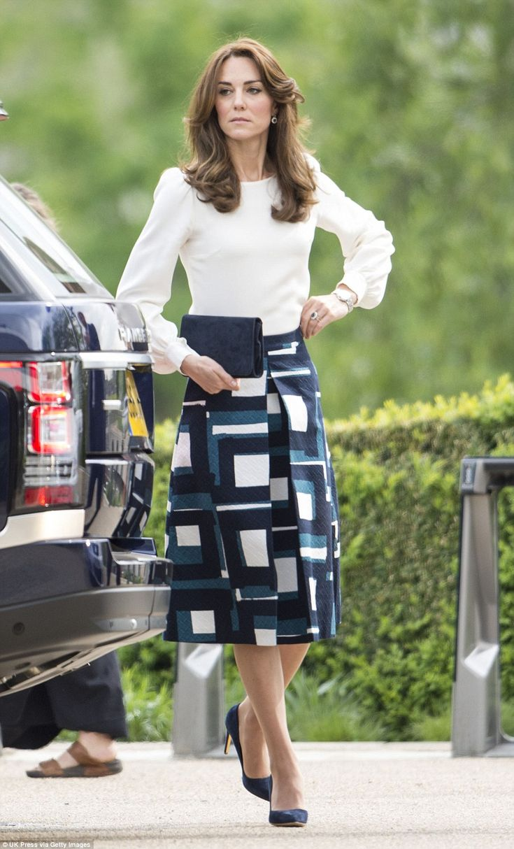 Kate made sure her blouse was perfectly tucked into her skirt as she prepared for the offi...