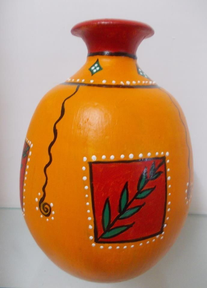 Vibrant looking pot painted using acrylic colours ...