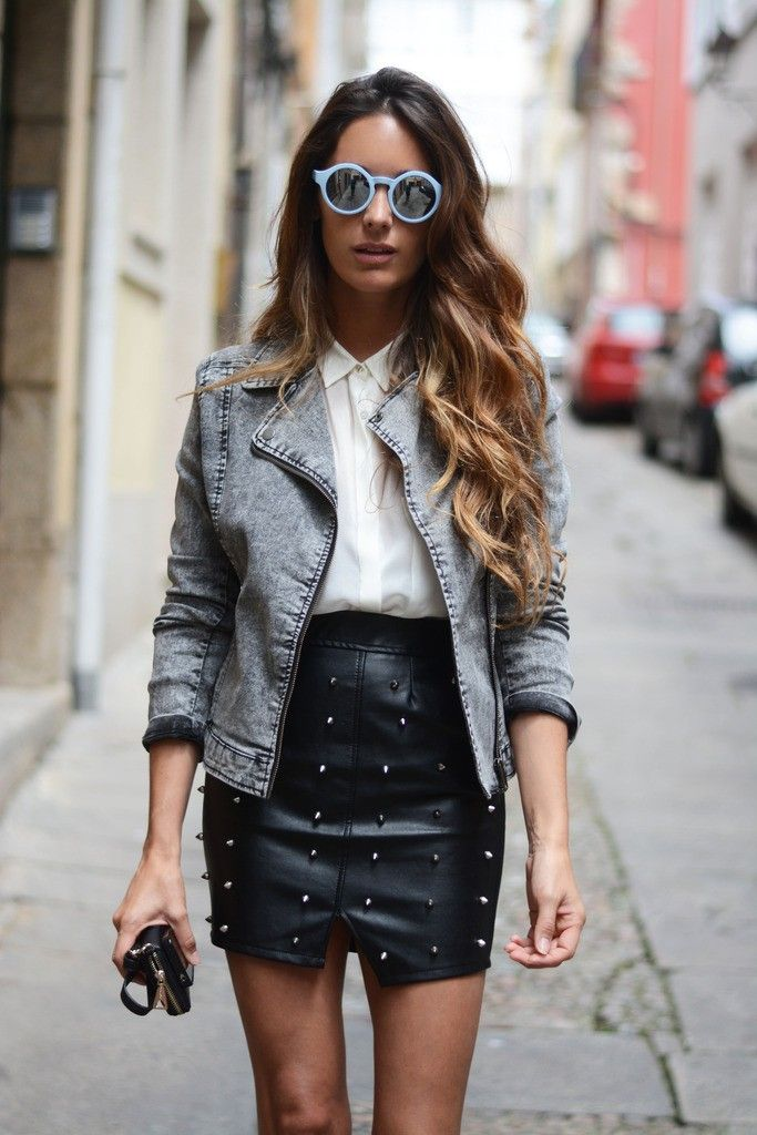 #Streetstyle - Edgy and glam look. Washed out denim jacket, white shirt, black leather studded #miniskirt and round shaped sunglasses.