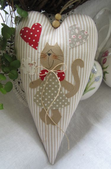 1397752181-941...A striped heart with an appliquéd cat...