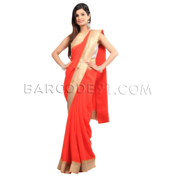 $356 Orange jacquard crepe saree is finished with antique border.It comes with mustard raw silk blouse piece.Slight variation is possible in color