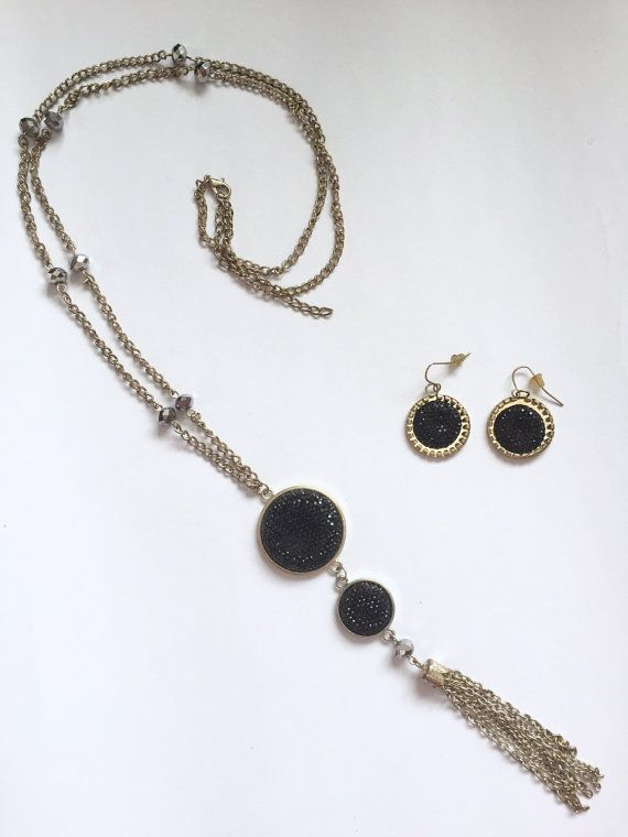 Beautiful and stylish long necklace and earrings from the 1980s. Black faux crystal pendants with chain tassel. Mirror-shine silvertone beads