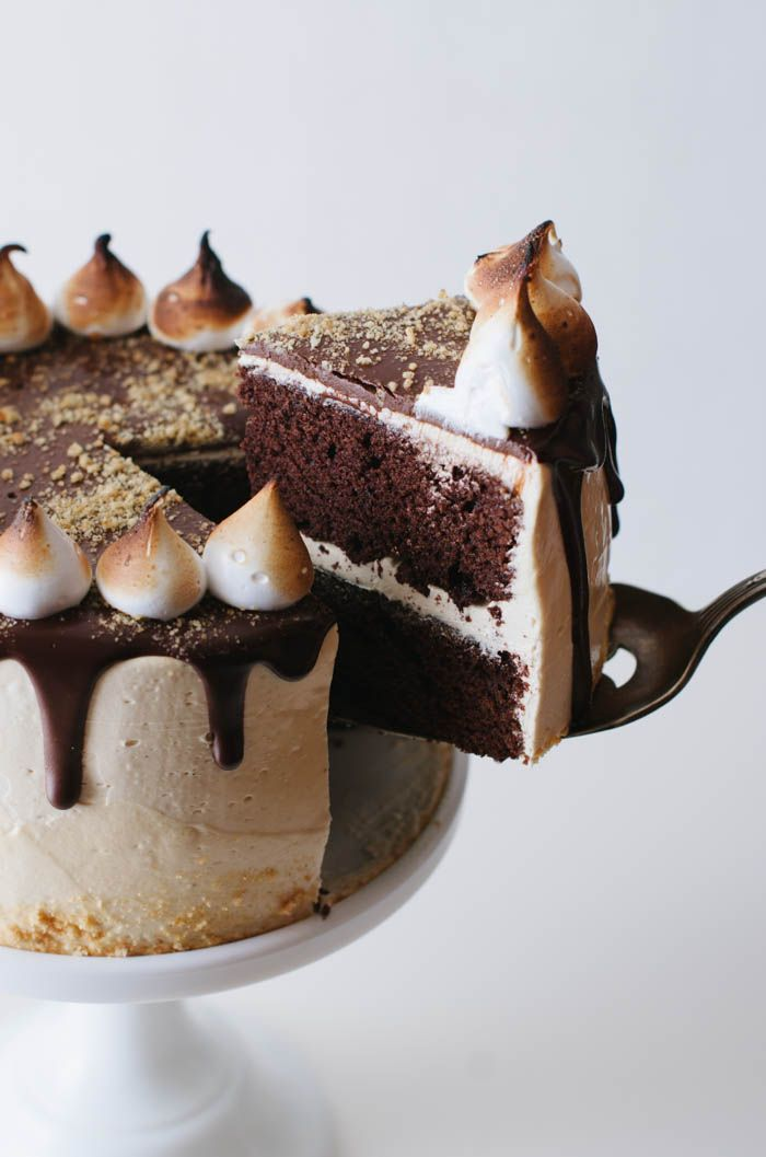 Peanut Butter Smore's Cake is a chocolate buttermilk cake topped with peanut butter swiss meringue buttercream, a chocolate ganache drizzle, graham crackers and toasted marshmallow meringue.