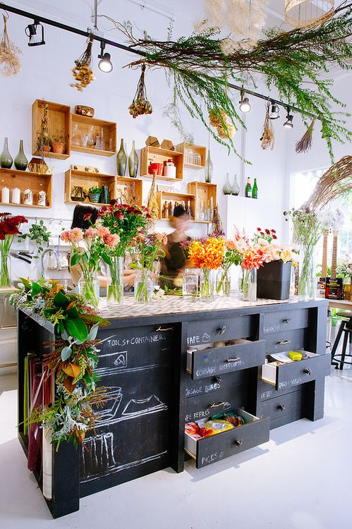 The Work Table with chalkboard labeled draws!! YESS Organized flower shop! @Bella Todd & Whistles @ the flower field