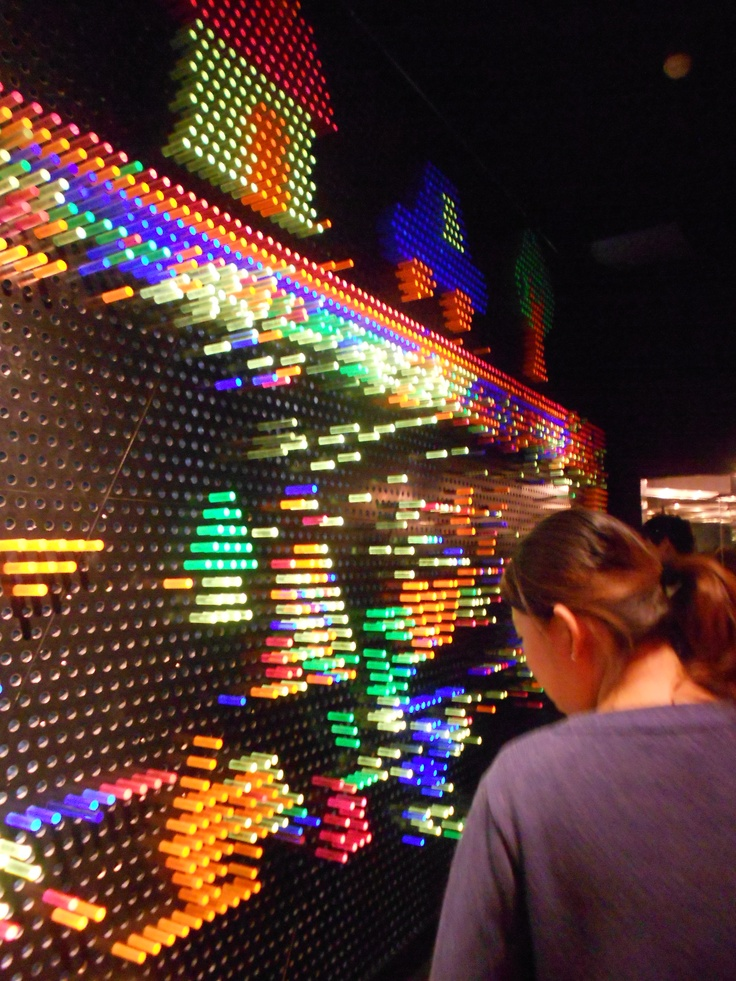 Simple coloured rods in a peg board with a light source behind - Shanghai Science and Technology Museum - Bec