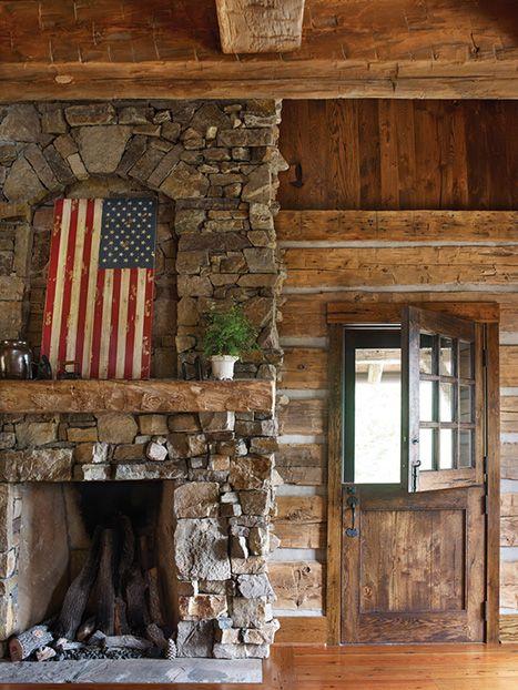 Photo Credit: Emily Followill. An American flag art piece hangs over the mantel at an Atlanta couple's vacation getaway cabin.—<em>Lake Toxaway, North Carolina</em>