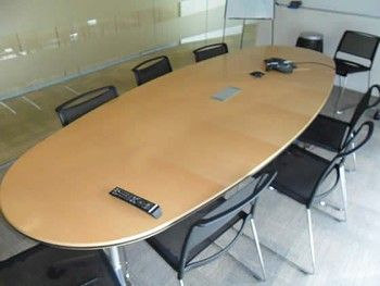 Wilkhahn boardroom table in maple veneer with silver legs.