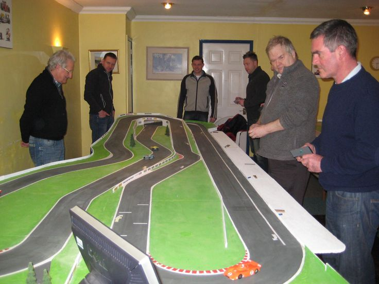 Drivers enjoying their racing on the Linford 1 Magracing circuit.   Cars are 1/32 scale,  powered by rechargeable batteries and can race for over 15 minutes on a charge.