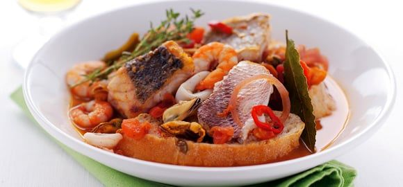 Cacciucco: Tuscany & Liguria mixed fish and seafood stew with tomato, onion and garlic.