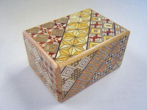 Japanese puzzle box- you have to slide pieces in the right order. This one has 12 steps.