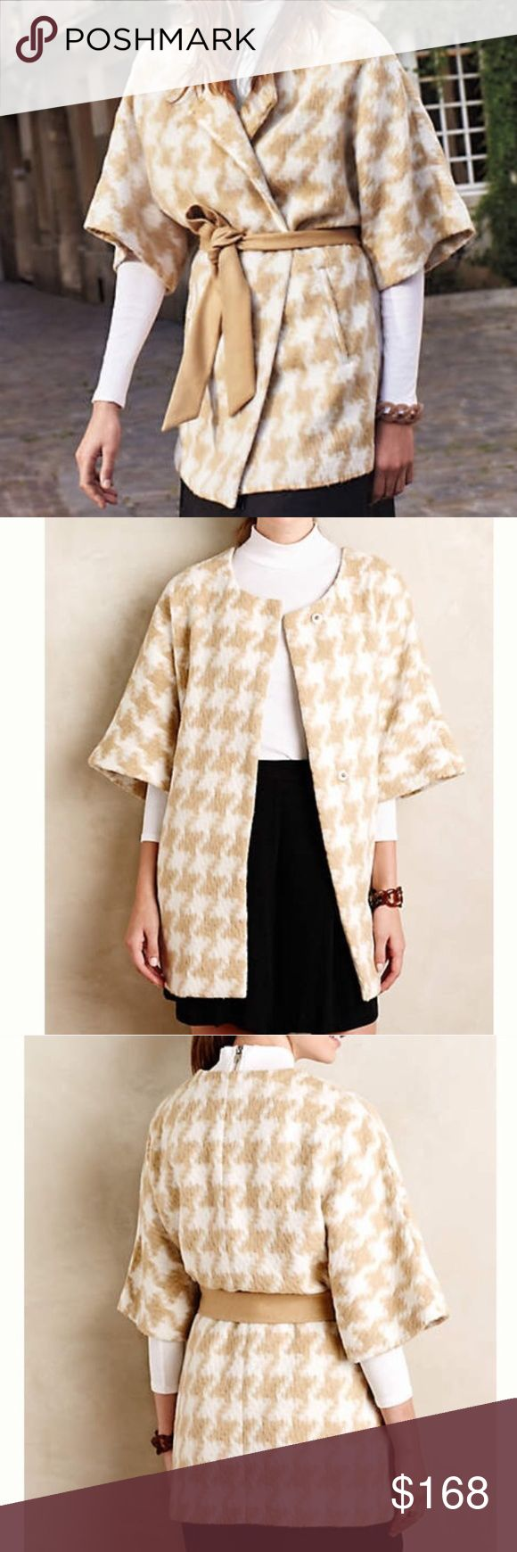 Anthroplogie Houndstooth wrap coat Houndstooth wrap coat- is kimono style but not exactly. It has buttons and can be worn many different ways. This is bnwt, never worn and has no blemishes of any kind. We love this as a fall staple that can transition through winter and spring as well. Classy houndstooth in beige and creamy white is fabulous! Can answer any questions. No returns ✨ Anthropologie Jackets & Coats