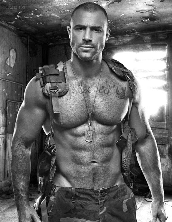 look closely at the tat on his chest and I say Yes he is! Mmmmmm...