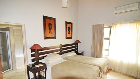 Bedrooms are air-conditioned and have en-suite bathrooms.