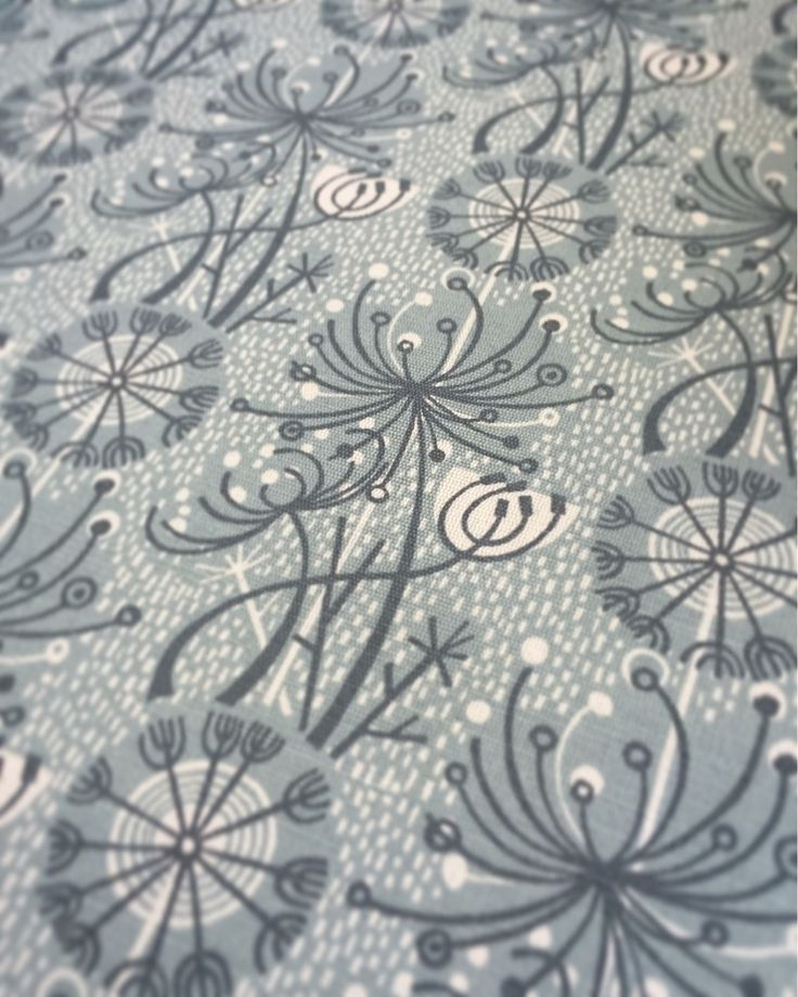 Angie Lewin's 'Dandelion One' fabric for St Jude's in sea mist/slate.