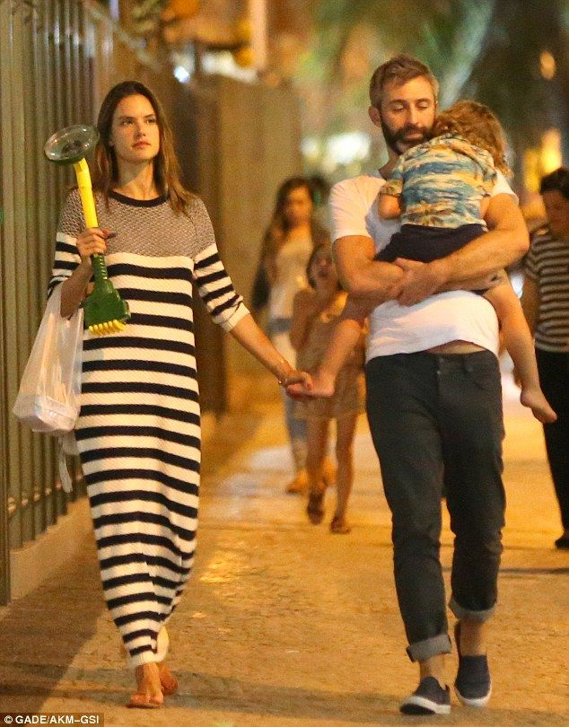 Cute: A few hours later she was seen out with her children and a friend for a late dinner...