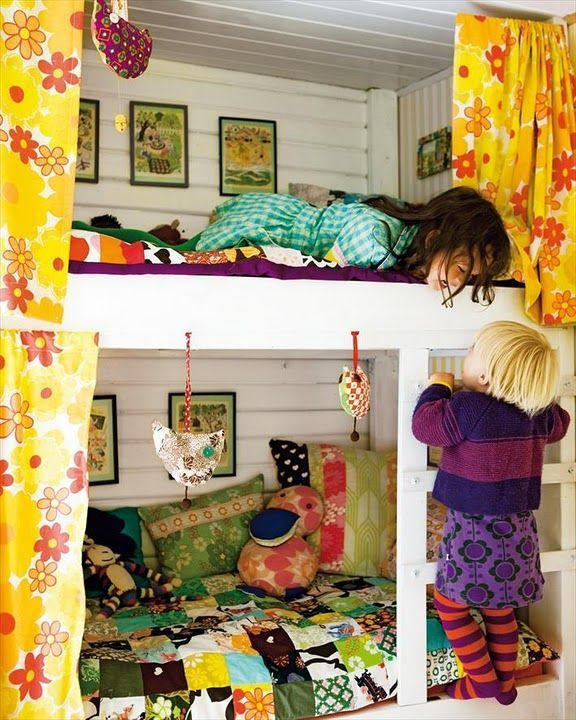 """What an amazing use of space. Notice how they hung pictures within each of the mini """"bedrooms"""". The mix of patterns and colors are vivacious and joyful. You can tell how these children relate to their room (and one another) just from this picture. Love, love, love!!!"""