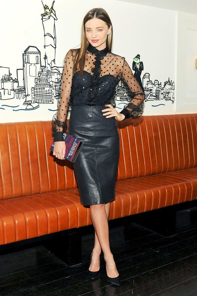 Miranda Kerr knows how to dress up for the holidays in a sheer blouse and leather pencil skirt.