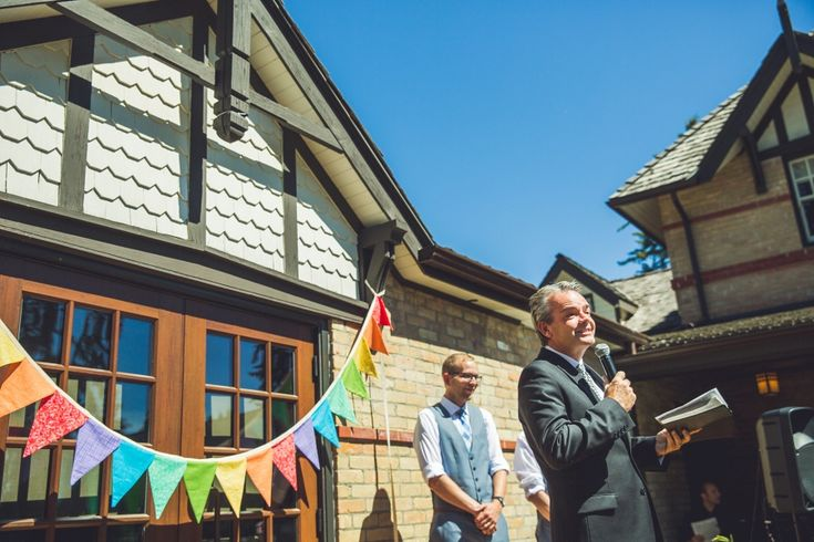 Love this rainbow flag banner for Tara and Ryan's wedding ceremony at the Bow Valley Ranche Restaurant! Calgary Wedding photography by Anna Michalska Photography. See the article for more from Tara & Ryan's Calgary summer wedding!