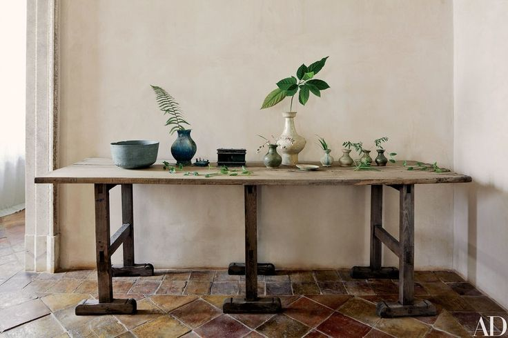 The living room's 18th-century French table showcases rare finds, including, at left, an antique pietra ollare bowl and a Han-dynasty bronze vase.