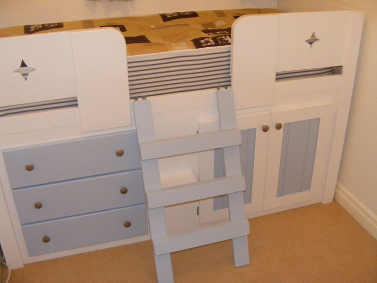 White and sky blue childrens cabin bed with star cut outs in the front rails. Aspenn furniture only uses solid natural woods of the highest quality in their furniture and childrens beds are guaranteed for 20 years. This bed has a sky blue ladder which is attachable to the bed. These beds can be made to fit into a certain space. Visit www.aspennfurniture.co.uk for more, contact number is 01937 843386 or email ianaspenn@btinternet.com