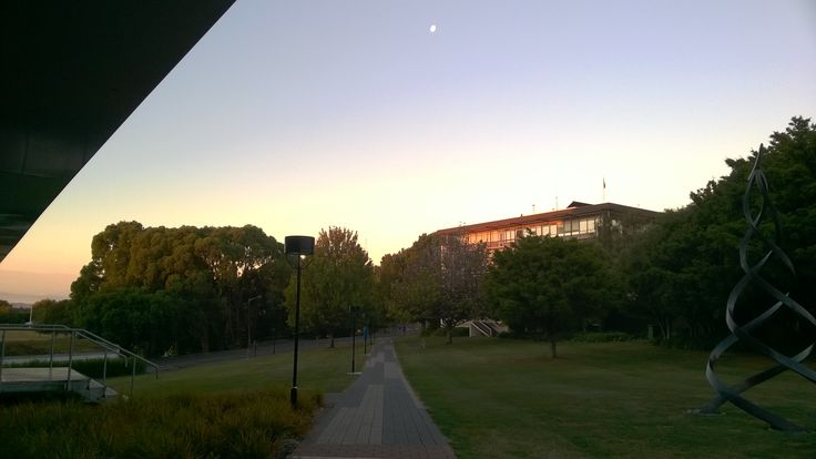 Sunset from my uni library. The moon is hanging there