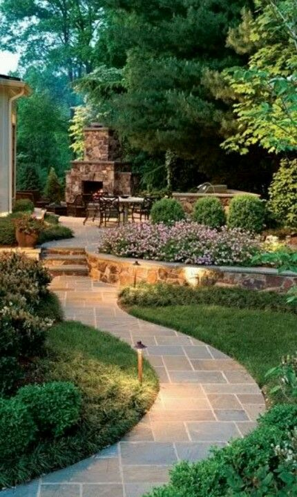 Meandering path leading to outdoor fireplace