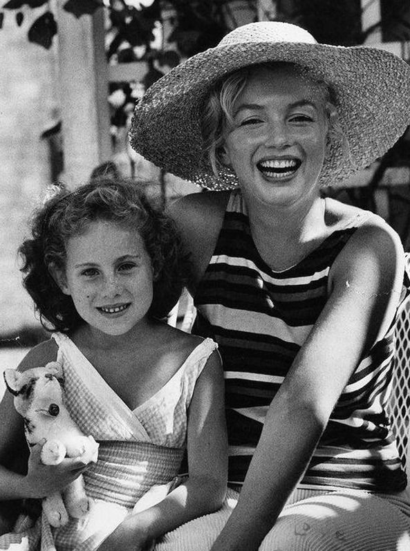 """Marilyn Monroe photographed with the daughter of her friend Norman Rosten during a vacation on Long Island, 1957. """