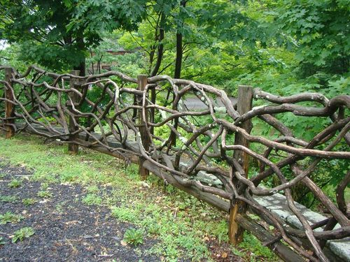 I love fences made from branches, although I imagine this would be tricky to make.