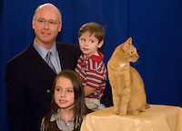 "Sept. 20, 2007: Rep. Robert Aderholt, his daughter Mary Elliott Aderholt, 8, and son Robert Hayes Aderholt, 3, pose for a photo with Tommy, the cat who appeared in the final episode of ""The Sopranos"" during the Animal Health Institute Pet Night on Capitol Hill in the Cannon Caucus Room."