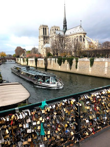 """Love Locks"" on the Archeveche Bridge in Paris, France. Loved ones hang a lock with their names on it and then throw the key into the river. Even if the relationship ends, the lock cannot be removed and stays forever as a testament to someone once a part of your life."