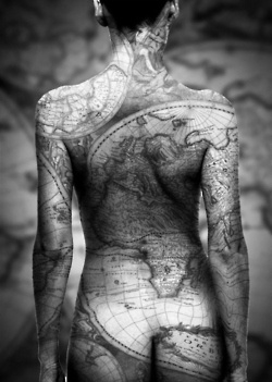 Tattoo of the globe all over her body!! Incredible!