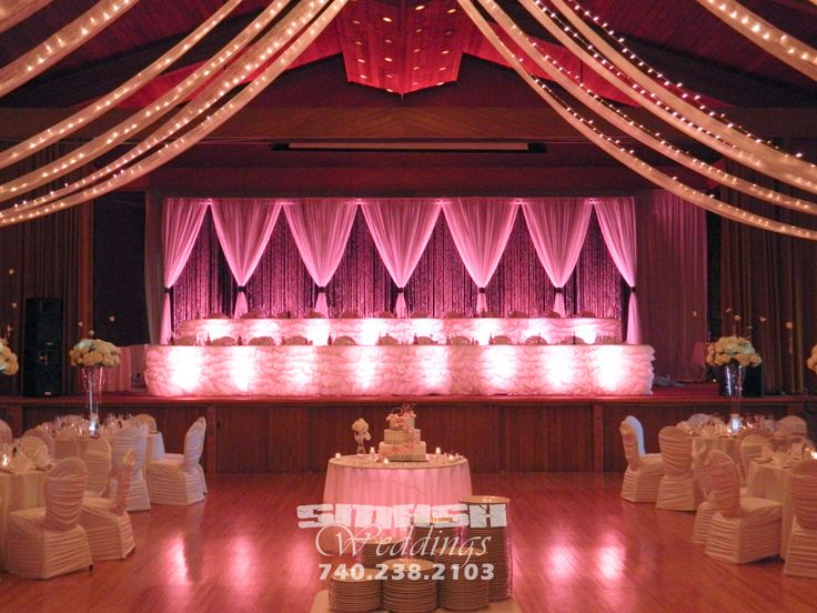 Backdrop and head table for wedding at glessner auditorium for Auditorium stage decoration