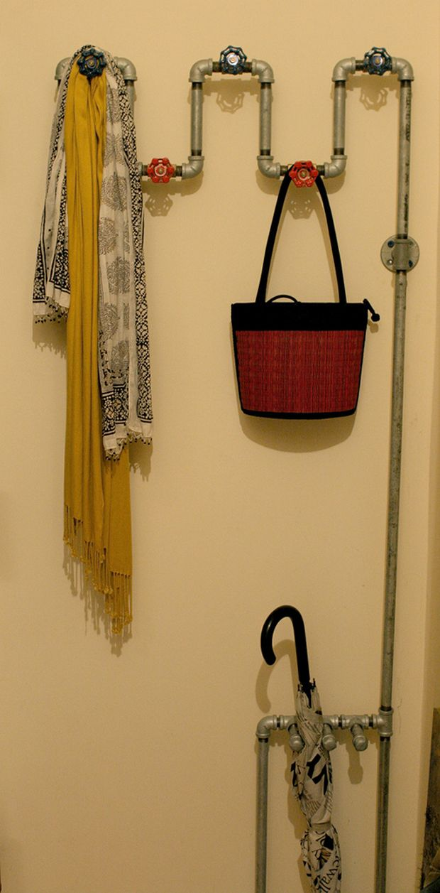 Spigot handles & pipe make a great hanging spot, along with an umbrella/cane rack.