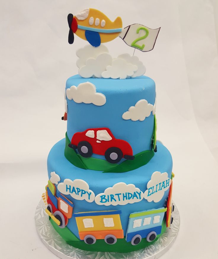 Vroom, vroom, choo choo, zoom! A fun transportation birthday party theme cake.
