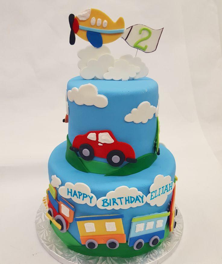 Vroom, vroom, choo choo, zoom! A fun transportation birthday party theme cake.