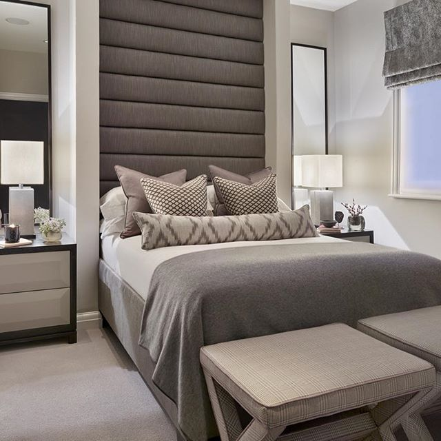 The oversized headboard in this compact guest bedroom gives the room presence and I love the cute upholstered X stools #luxuryinteriors #int...